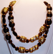 Gold Carved Beads, Black Beads and Crystal Beaded Necklace