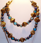 Gold Carved Vase Beads, Blue Glass and Lapis Lazuli Necklace