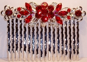 Crystal Comb Pair-Flowers Silver Metal Ruby Crystals. Other colors available are Amethyst, Aqua, Black, Clear Crystal, Fuchsia Pink, Peridot, Sapphire, and Topaz (see JCCO001).