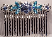 Crystal Comb Pair-Flowers Silver Metal Aqua Crystals. Other colors available are Amethyst, Black, Clear Crystal, Fuchsia Pink, Peridot, Ruby, Sapphire, and Topaz (See JCCO001).